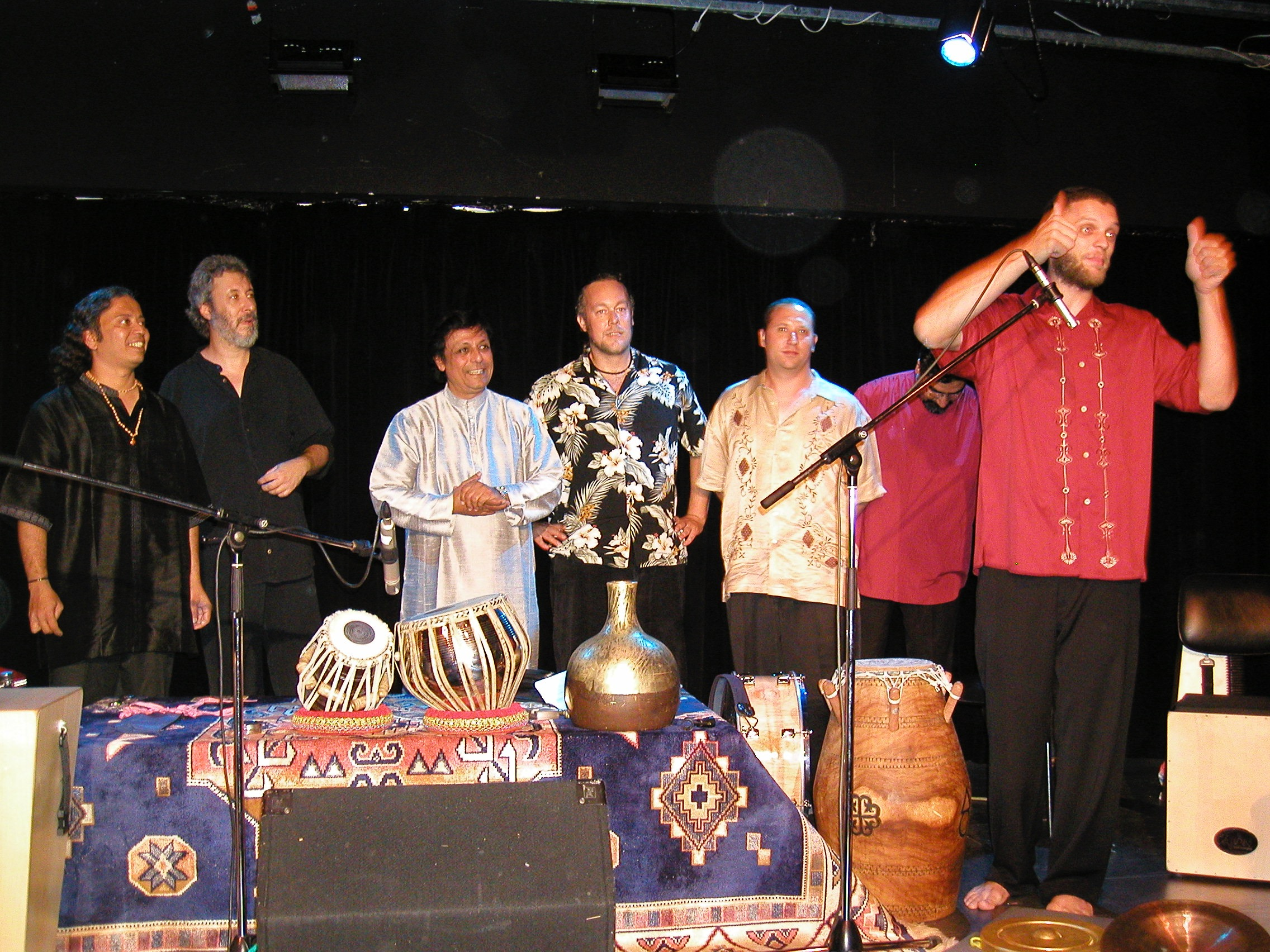 End-of-the-concert.-Campinas-Brazil-2004-left-to-right-Poovalur-Sriji-Adam-Rudolph-Pandit-Swapan-Chaudhuri-Austin-Wrinkle-Randy-Gloss-Houman.jpg