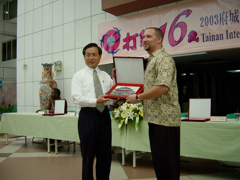 Randy recieving a gift from the Mayor of Tainan city. Taiwan, 2003