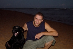 Andrew Grueschow (the dog whisperer) making friends. Praia do Forte, Brazil, 2004